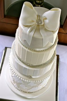 Ivory & White Wedding Cake by ConsumedbyCake #weddingcakes