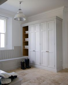built in storage seating. Drawers beneath, cabinets above. SLIDING DOOR WARDROBES as studio-closet combo above/behind the dining banquette bench.