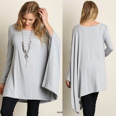 """Diorama"" Long Sleeve Draped Side Top Half long sleeve half draped top. An absolutely must have, fun piece! Available in black, ivory, jade and silver. This listing is for the SILVER. Brand new. Loose fit. S (2-6), M (8-10), L (12-14). NO TRADES DON'T ASK. Bare Anthology Tops Tees - Long Sleeve"