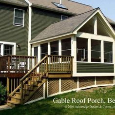 The cathedral ceiling in this 3 season porch allows fixed glass in the gable end.  Fully trimmed exterior blends the porch with the house.
