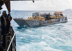SHOALWATER BAY, Australia (July 13, 2017) Sailors launch Landing Craft Utility (LCU) 1651, assigned to Naval Beach Unit (NBU) 7, from the well deck of the amphibious dock landing ship USS Ashland (LSD 48) to deliver supplies to Marines attached to the 31st Marine Expeditionary Unit (31st MEU) on shore as part of a large-scale amphibious assault during Talisman Saber 17. Ashland, served in a combined U.S.-Australia-New Zealand amphibious force.