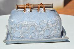 Ceramic light blue butter dish with paisley texture and natural dark bamboo…