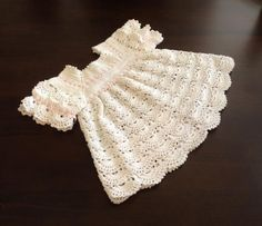 White Sunday Dress Crochet Pattern  Easy to make, beautiful to wear! This cute dress has a touch of elegance that will make your baby look so cute and elegant, all at the same time! Make the skirt longer, and you have a gorgeous Christening Gown!