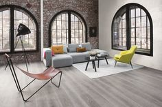 A raw brick wall and large industrial windows are a perfect backdrop. BOEN Parkett