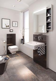 Bathroom is not all tiled; cost saving. Floor tile lovely. Wall art. Basin choice.