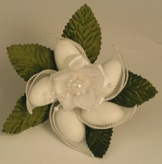 Almond flower for favor and table decoration; other styles available from this vendor http://www.favoronline.net/5jordanalmondsflowerbouquetfavorwfancyrose.aspx