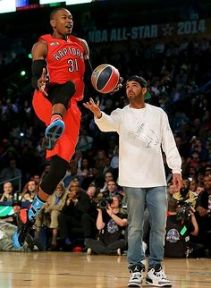 February 15: All-Star Terrence Ross #31 of the Toronto Raptors takes the ball from Drake during the Sprite Slam Dunk Contest 2014 as part of the 2014 NBA All-Star Weekend in New Orleans, Louisiana.
