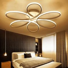 An elegant statement of eye-catching, architectural design, featuring a flower structure with a seamless array of light. In modern spaces, the Manca Modern LED Ceiling Light adds other-wordly style, with soft-sided aluminum sides curving into each. Ceiling Design Living Room, Bedroom False Ceiling Design, Home Ceiling, Bedroom Ceiling, Living Room Lighting, Living Room Designs, Ceiling Fan, Home Interior, Interior Styling