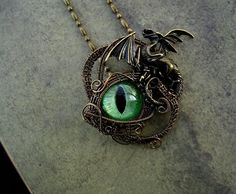 Wire wrapped Gothic Steampunk - Bronze Dragon Eye - by LadyPirotessa, $33.48 USD. Inspiration for rescue jewelry fundraising.