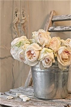 ♥ Gimme a tin can and some roses any day!!
