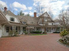 Past the electronic gates and up the long driveway, Howard's home exterior features a hand-laid brick driveway.