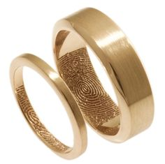 These warm-toned wedding bands are handcrafted in 14k rose gold, with your loved one's fingerprint on the inside. See more here: http://www.brentjess.com/product-page?prodid=1664