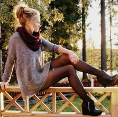 Sweater dress with a scarf, stockings, and booties