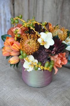 Nisie's Enchanted Florist -- Welcome fall with these amber and autumn colors with a hint of plums and purples; Orchid Flower Arrangements, Floral Centerpieces, Floral Bouquets, Orange Orchid, Orange Flowers, Tropical Flowers, Flora Botanica, Enchanted Florist, Flowering Trees