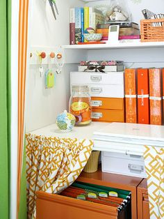 Love the Labels              Metal file cabinets -- painted orange to match the room's decor -- store important documents and are safely hidden behind an extra curtain attached to the bottom shelf. Labels inside file cabinets and on storage boxes also make it easy to stay organized