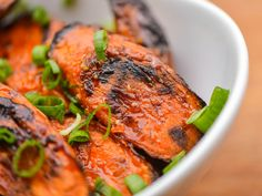These carrots develop a natural sweetness as they're roasted on the grill. A finishing brush with a honey and soy sauce mixture leaves them with a glistening glaze that has a salty depth and a mild ginger and garlic bite.