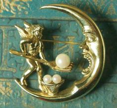 From the Victorian Trading Co Crescent Moon Caviar Brooch A diligent angel forks over the pearls to make the new moon full. X Faux Pearls Metal is nickel free white metal casting with gold electroplate. Moon Jewelry, Pearl Jewelry, Jewelry Box, Jewelry Accessories, Zipper Jewelry, Jewellery Earrings, Women's Jewelry, Wedding Accessories, Victorian Jewelry