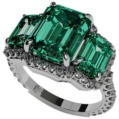 7.00ct Three Stone Emerald Diamond Ring    From a unique collection of vintage engagement rings at https://www.1stdibs.com/jewelry/rings/engagement-rings/