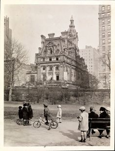 Children playing at Central Park, the distance is the Clark mansion, NYC, ca. 1910s