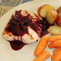 Blueberry balsamic sauce serves as a sensational topping for grilled salmon in this summery dish.