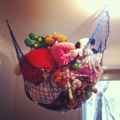 how we solved the soft toy clutter problem. trailer net from Bunnings screwed to the roof