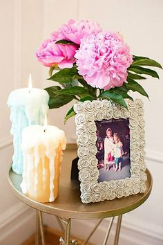 """Wicked Drip Candle. (Looks a bit sinister with the overly beautiful and equally large flowers and the flowery, girly-girl frame--fit for a dark romantic who is into berry lipstick and, er, """"bizarre"""" rituals, no? Lovely, lovely, lovely... pass the salt and eye of newt)."""