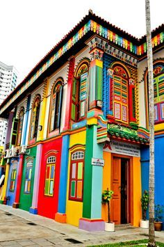"""This beautiful colorful building is located in little India, Singapore. The architecture is very vintage looking, however the colours do give a modern and """"summery"""" vibe. These summer colours go well with Singapore's hot weather. Colourful Buildings, Beautiful Buildings, Beautiful Places, Colorful Houses, Unusual Buildings, Beautiful Streets, Little India Singapore, Singapore Travel, Singapore Singapore"""