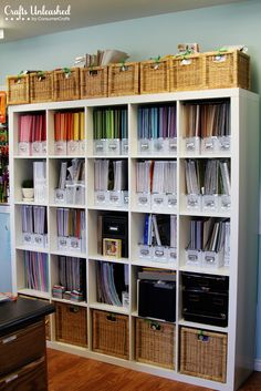 Craft Room Tour: Organizational Ideas For A Crafter's Paradise....vertical paper storage. seems so much easier to access than stacking