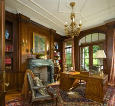 Office with wood paneling detail in a French Classical House in Highland Park, TX. French Architectural designs by Richard Drummond Davis Architecture.
