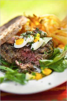 This is a souped-up beef burger made with traditional steak tartare seasonings. (Photo: Francesco Tonelli for The New York Times)