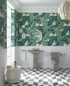 Wallpaper is back in home decor and bringing with it an explosion of bright colors and bold graphics in larger-than-life designs like this palm leaf motif inspired by Dorothy Draper's iconic use of pattern.