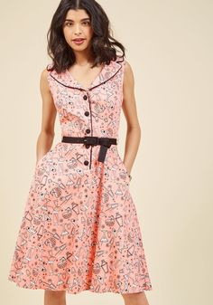 <p>Looking blissfully around the room, you see your retro cocktail party is just how you envisioned - your pink shirt dress, especially! A sassy look befitting of the occasion, this pocketed number keeps the fun times coming with its black and white print of libations galore, worthy of a toast in every way!</p>