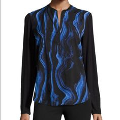 "HPTahari Sz S Black Blue Half Soft Blouse NWT Tahari Sz S Black Blue Half Button Up Soft Rayonlong sleeve BlouseLength 28"" Sleeve Length 24""  Bust 34-36 (a little bit oversized) New With Tags! Tahari Tops Blouses"
