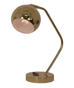 Illuminate your work space in contemporary fashion with this sleek task lamp boasting an opulent spherical shade.