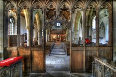 Gothic Revival. Equally spaced arches, recessed arches, tracery