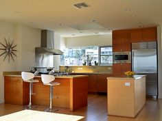 Modern And Minimalist Open Floor Plan Kitchen And Living Room - Use J/K to navigate to previous and next images