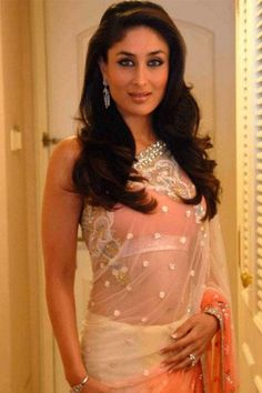 New Bride in town: Kareena in an orange saree with silver embellishments - bollywoodshaadis.com