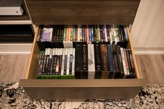 Hide away any controllers, games, or accessories for your gaming consoles into pull out drawers to keep the gaming area neat and tidy. Media Room Design, Wall Design, Small Media Rooms, California Closets, Pull Out Drawers, Media Wall, Neat And Tidy, Custom Cabinetry, Media Center