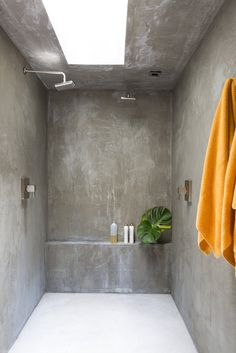 The bathroom walls are finished in concrete.