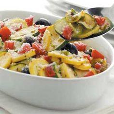 Greek-style squash - yellow squash, zucchini, tomato, olives, onions, olive oil, lemon juice, oregano, garlic salt, Parmesan cheese