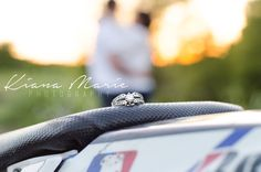 Close up engagement ring shot on dirt bike seat. #Motocross #EngagementRing #Engagement #Engaged #Love #Wedding #WeddingRing #Couple #Dirtbike #MotocrossEngagement #MotocrossWedding #Diamond #Photography #WeddingPhotography #TexasPhotography #TexasWedding #TexasEngagement #Sunset #Romantic