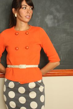 Ok i'm loving this tangerine top and the polka dotted skirt....