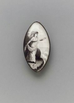 Brooch - American, about 1800  A brooch with ring for hanging as pendant, pointed oval in shape, gilded back, face glass over painted with lady in white.  mfa-Boston