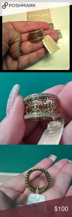 Michael kors ring Yellow gold non tarnish with swarvoski crystals mk symbols all around ring...beautiful and discontinued Michael Kors Jewelry Rings