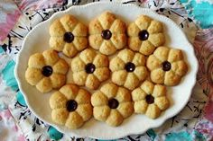 South African condensed milk biscuits (Kondensmelk koekies)    Condensed milk biscuits are well-known in South-Africa. They are similar to New Zealand condensed milk biscuits, but contain egg.    The dough is soft and very pliable, which means you can shape your biscuits with a cookie press, or even a meat grinder with a cookie attachment, if you are so lucky to own one.