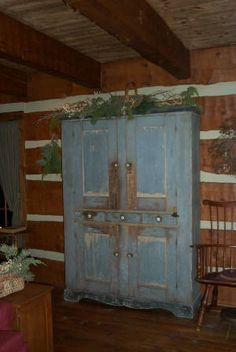 ♥......love this cupboard...such a pretty color against the log walls