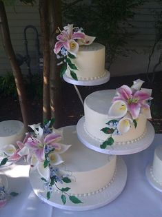 Butter Cream Cake With Sugar Stargazer Lilies, Calla Lilies And Stephanotis With Ladybugs This was for a very casual lakeside wedding and. Wedding Cake Fresh Flowers, Small Wedding Cakes, Elegant Wedding Cakes, Beautiful Wedding Cakes, Beautiful Cakes, Casual Wedding, Floral Wedding, Wedding Cake Decorations, Wedding Cake Designs