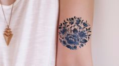 love this floral tattoo - and the blue!