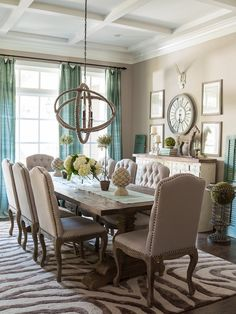 The coffered ceiling, robin's egg blue, the decor - this dining room looks great!