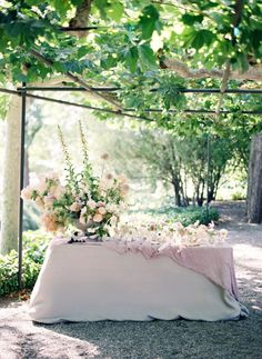 Garden wedding escort card table: http://www.stylemepretty.com/2016/04/20/chic-garden-wedding-with-a-rich-moody-color-palette/ | Photography: Jose Villa - http://josevilla.com/